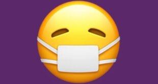 Güler yüzlü maskeli emoji